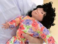 Манекен для ухода за  детьми с синдромом Дауна